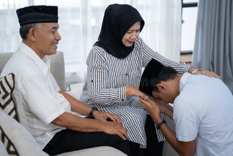 Asian muslim shake hand tradition royalty free stock photo