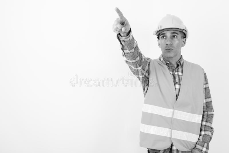 Mature Persian man construction worker in black and white royalty free stock images