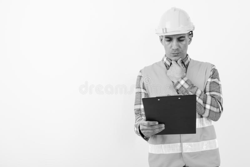 Mature Persian man construction worker in black and white stock photography