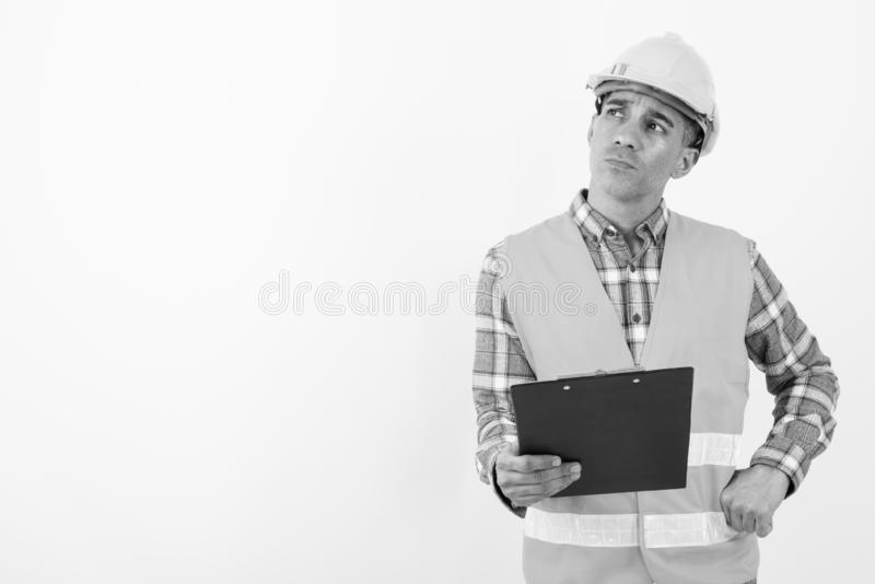Mature Persian man construction worker in black and white stock images