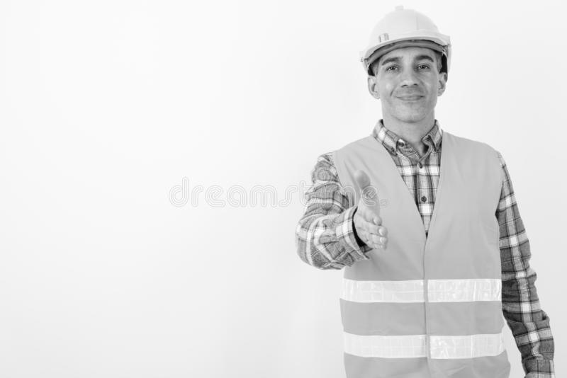 Mature Persian man construction worker in black and white royalty free stock image