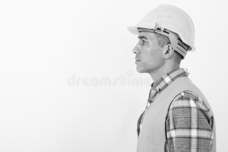 Mature Persian man construction worker in black and white royalty free stock photo