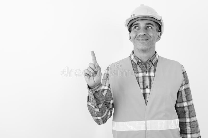 Mature Persian man construction worker in black and white royalty free stock photography