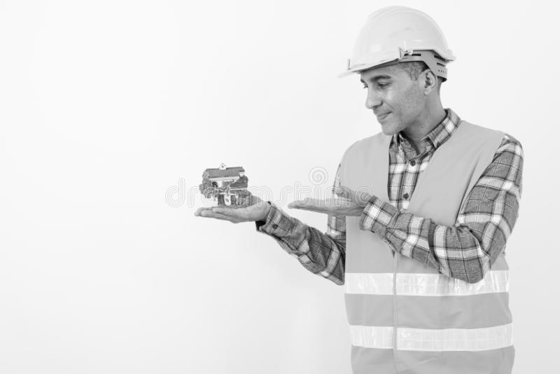 Mature Persian man construction worker in black and white stock photos