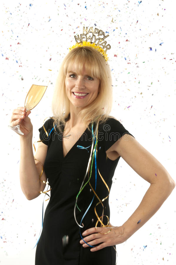 Mature pretty blond woman celebrating with a glass stock image