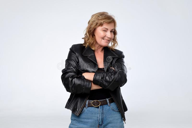 Mature pretty european woman in black leather jacket. stock photo