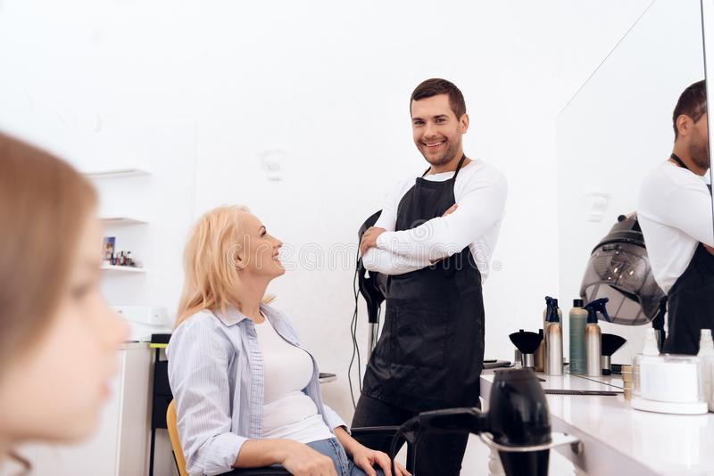 Mature pretty woman is doing hairdo in beauty salon. Female stylish haircut. royalty free stock photos