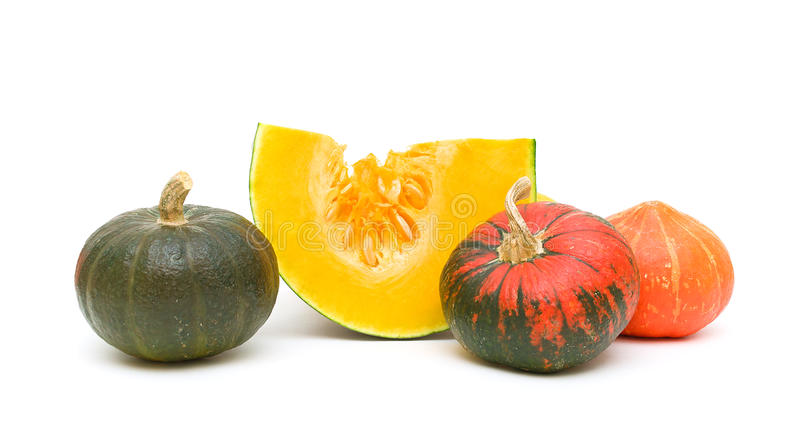 Mature pumpkins on a white background. horizontal photo. Mature pumpkins of different colors isolated on a white background. horizontal photo stock photo