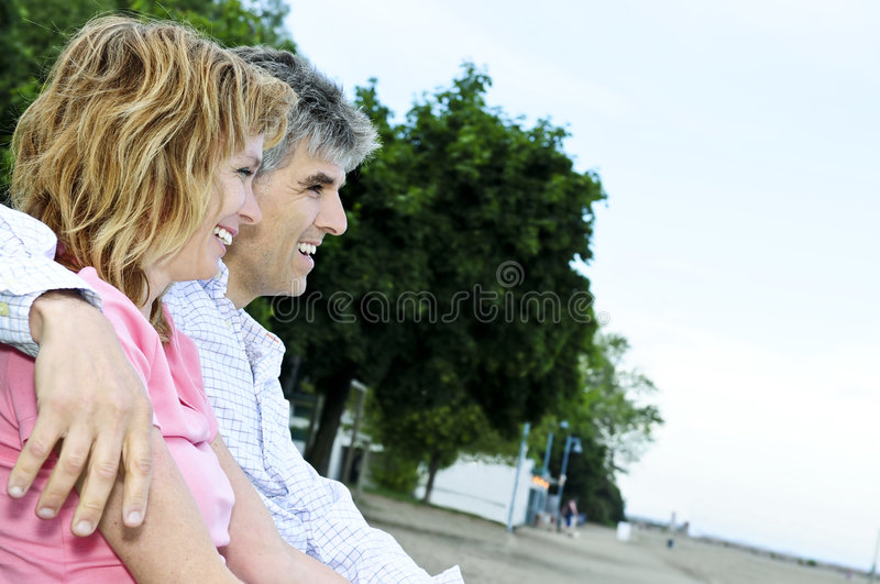 Mature romantic couple on a bench stock image