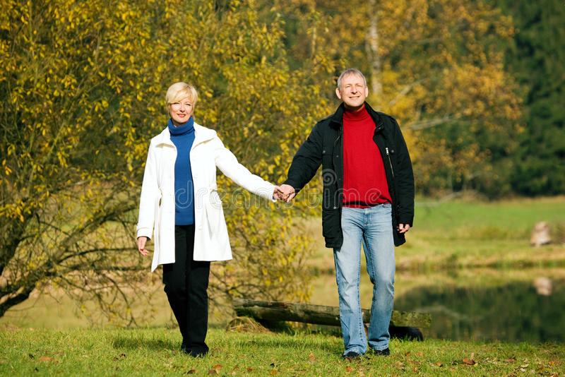 Download Mature Romantic Couple In A Park Stock Photo - Image: 12408824