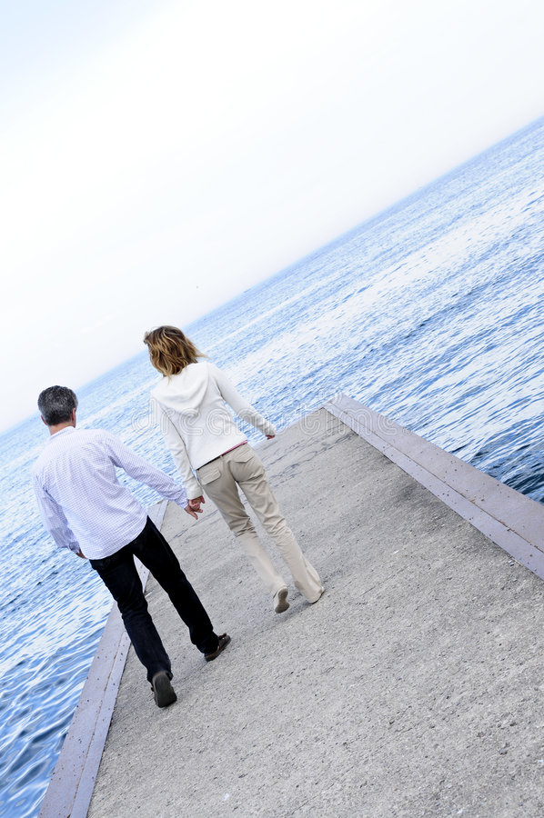 Mature romantic couple on a pier royalty free stock image