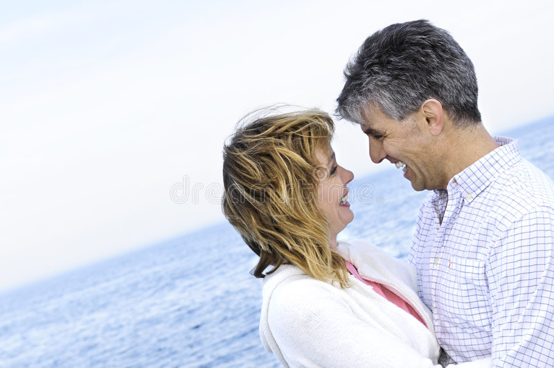 Mature romantic couple at seashore royalty free stock images