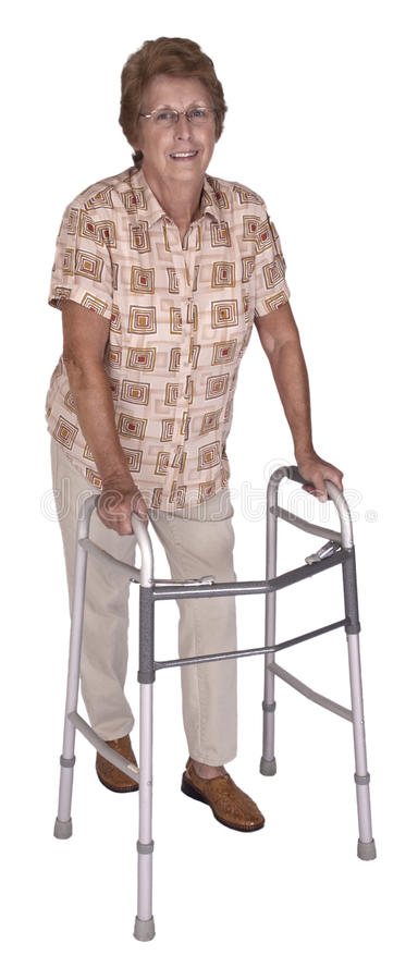 Mature Senior Elderly Woman Walker Aid Isolated. Happy and smiling mature senior elderly woman uses a medical aid walker to walk and be mobile. Maintaining royalty free stock images