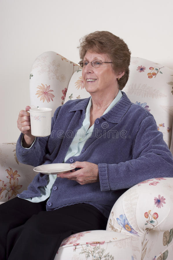 Mature Senior Woman Entertaining Drinking Coffee stock photo