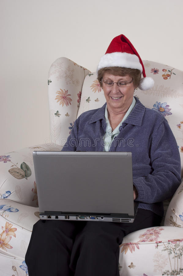 Mature Senior Woman Online Christmas Shopping stock photo