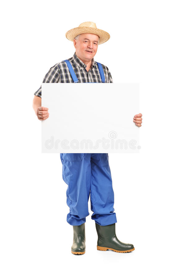 Mature smiling farmer holding a banner royalty free stock images