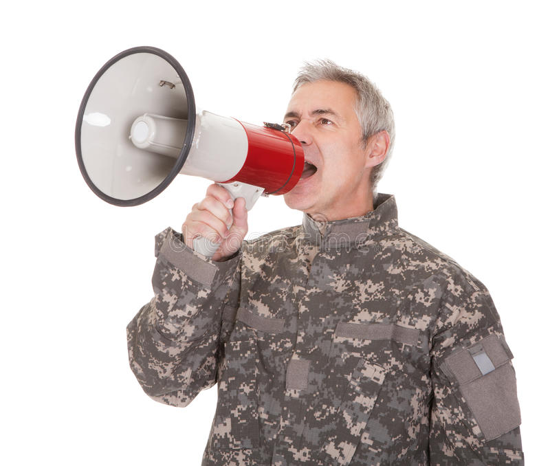 Mature Soldier Shouting Through Megaphone. Isolated On White Background stock photo