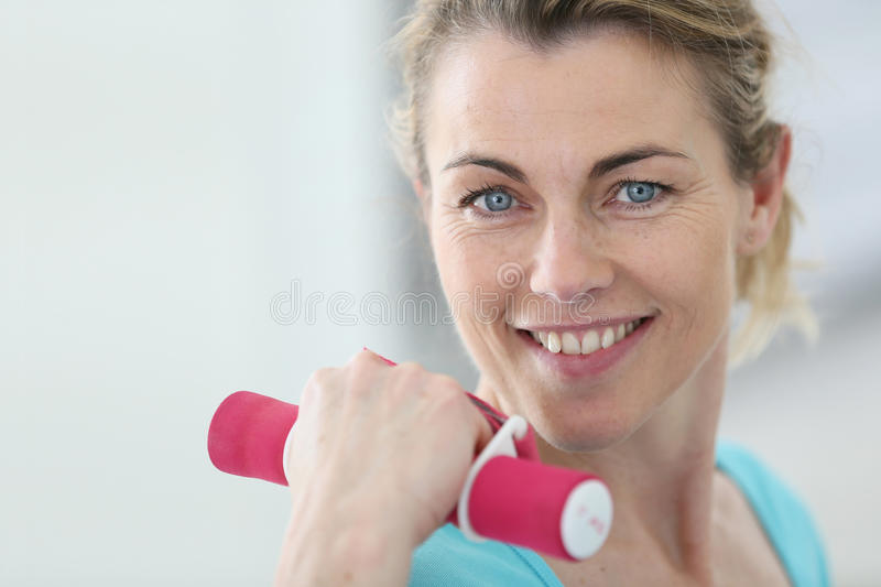 Mature sportive woman doing fitness royalty free stock photography