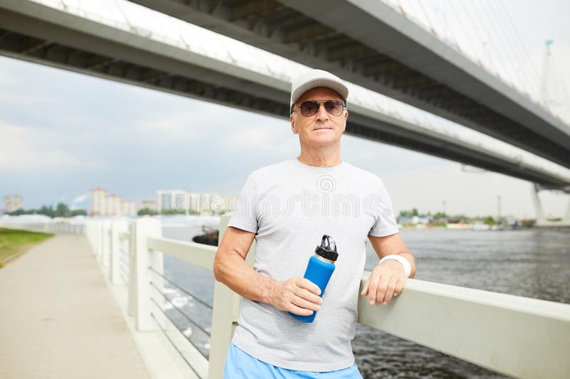 Sportsman with water bottle royalty free stock images