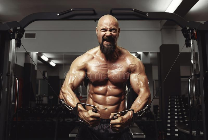 Mature sportsman exercising at the gym stock photos