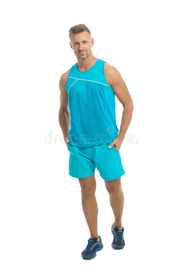 Mature but still young. Guy sport outfit. Fashion concept. Man model clothes shop. Sport style. Menswear and fashionable. Clothing. Man posing confidently white stock image