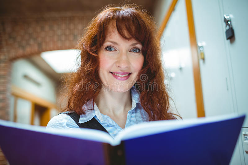 Mature student smiling at camera in hallway stock image