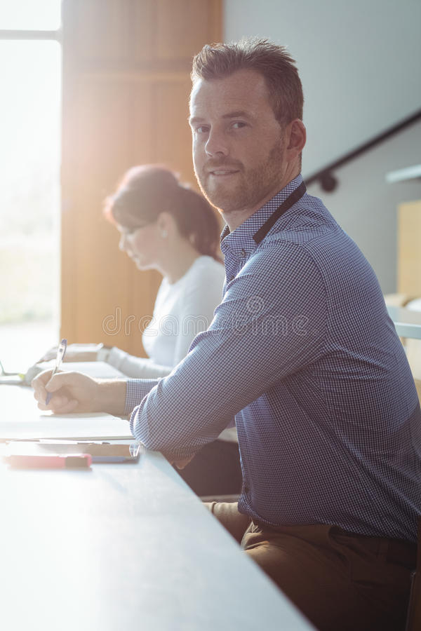 Mature student writing notes stock images