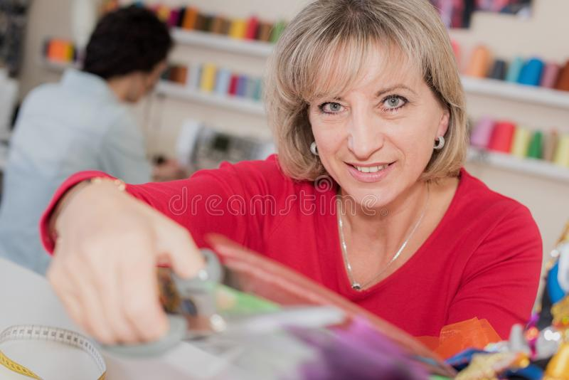 Mature students studying fashion and design stock photo