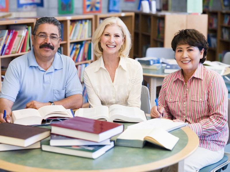 Mature students studying in library royalty free stock photography