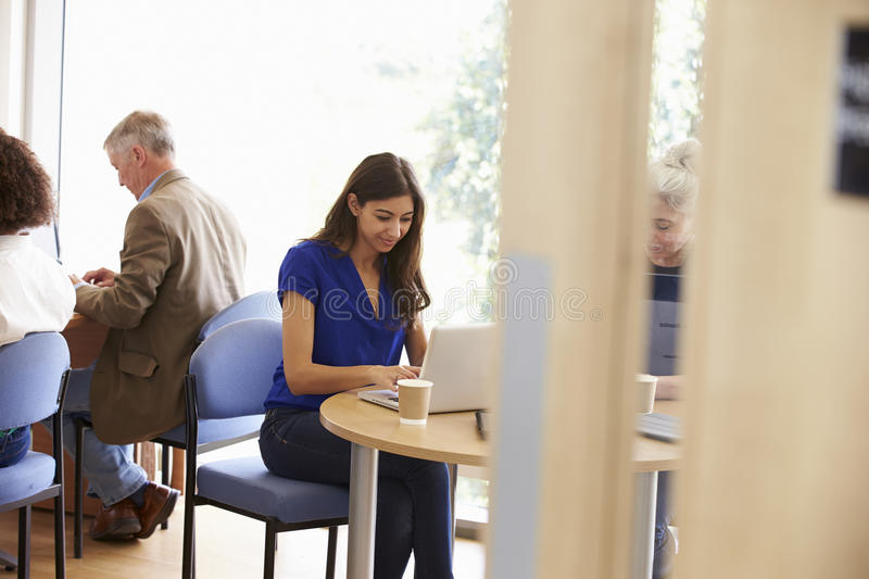Mature Students Working In College Breakout Area stock image