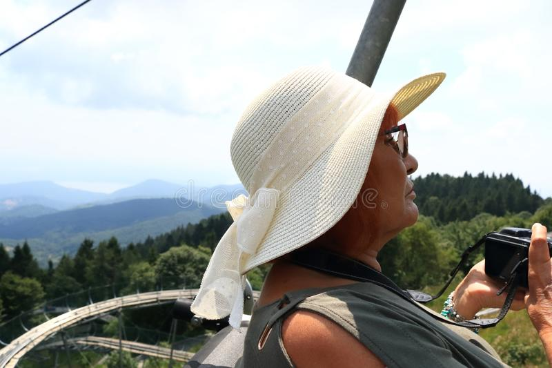 Mature tourist woman riding a cable car Stresa-Mottarone Italy stock image