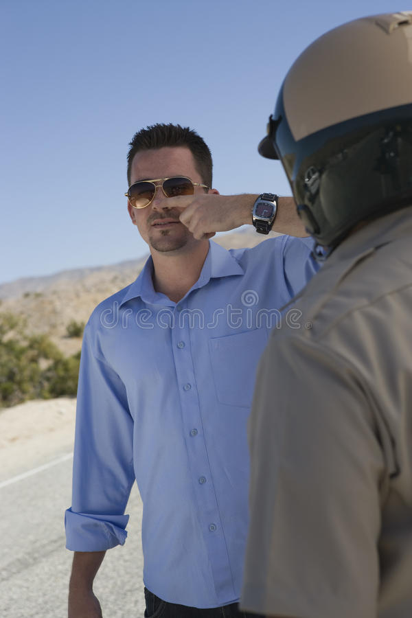 Free Mature Traffic Cop Taking Sobriety Test Stock Photography - 29651262