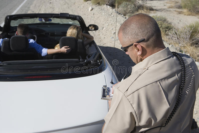 Download Mature Traffic Cop Writing Ticket Stock Photo - Image of control, crime: 29651320