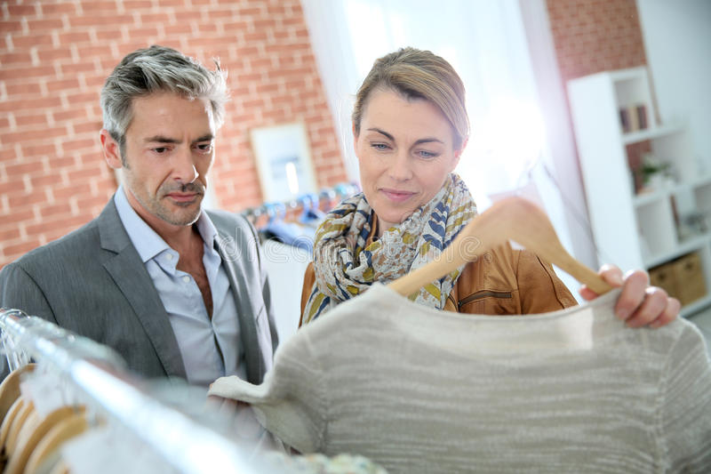 Mature trendy couple buying clothes royalty free stock photos