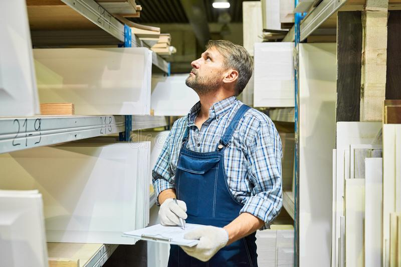 Mature Warehouse Worker Doing Inventory stock images
