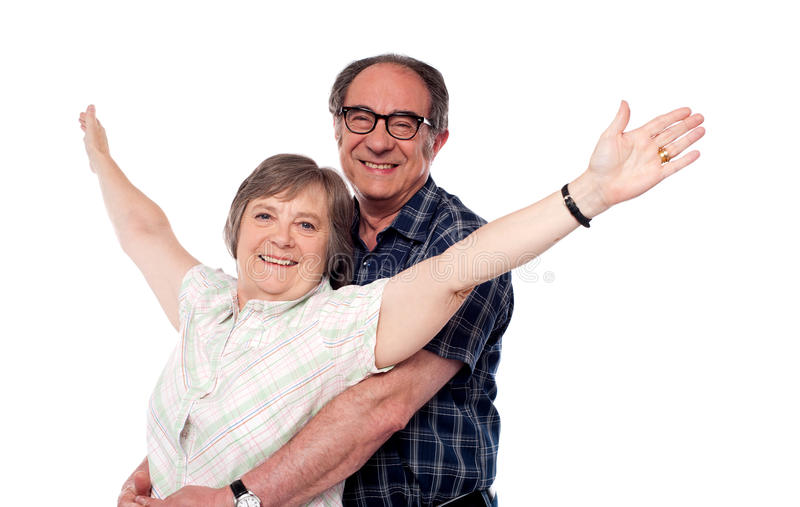 Mature woman with arms outstretched royalty free stock images