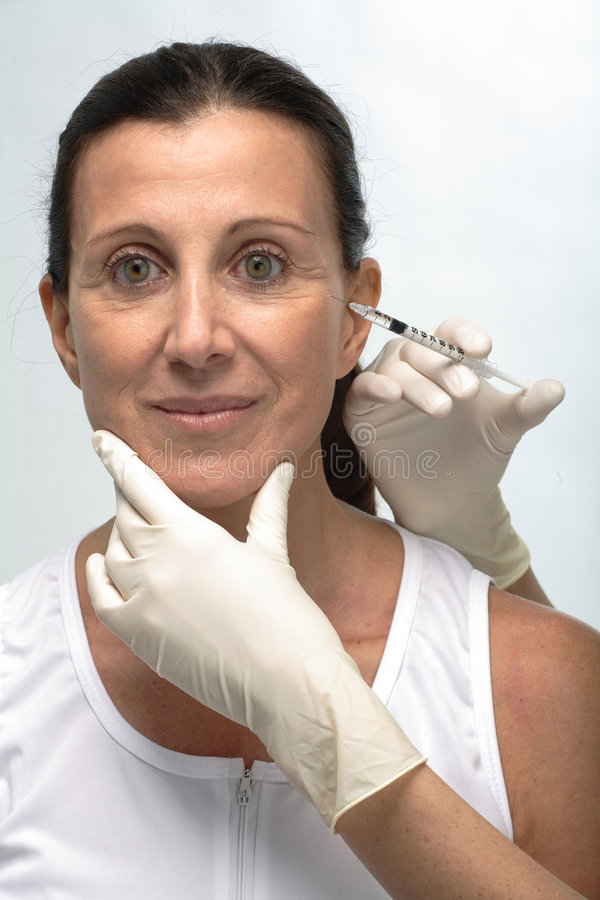 Mature woman botox royalty free stock image