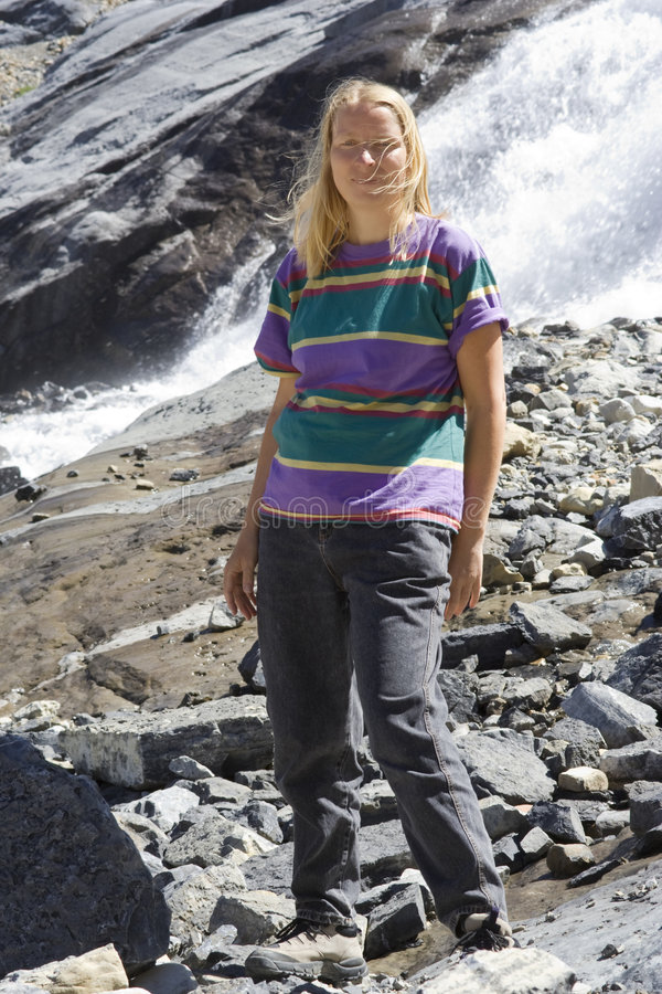 Mature woman at bow glacier falls stock photography