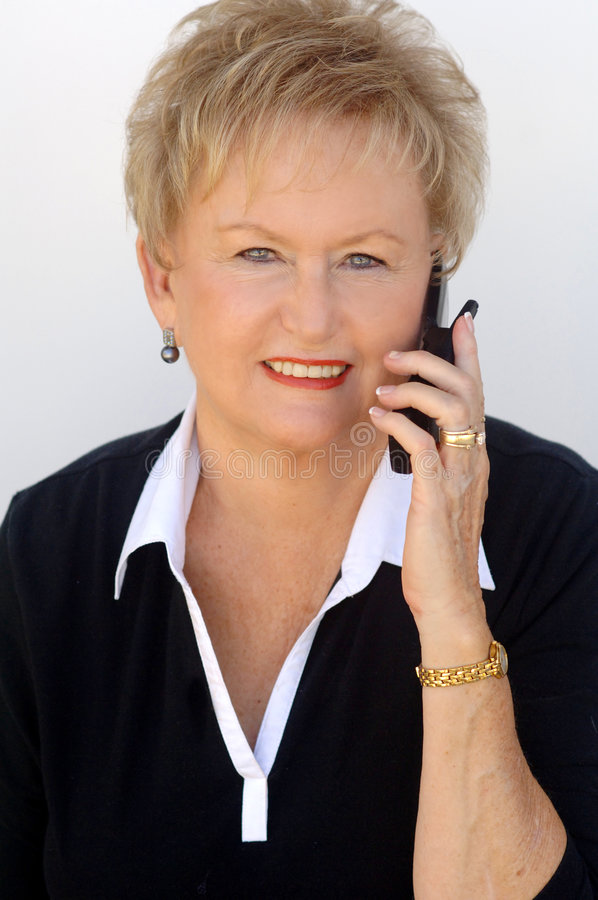 Mature Woman On Cell Phone Stock Images