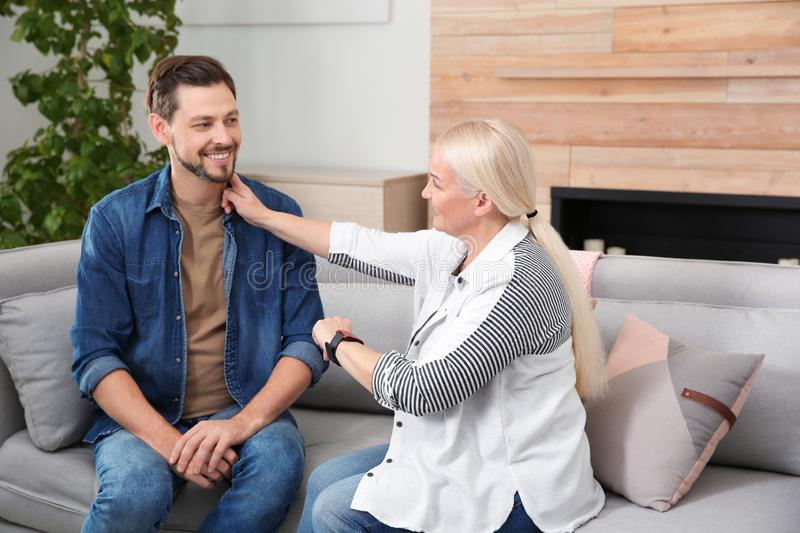 Mature woman checking man`s pulse with fingers stock image