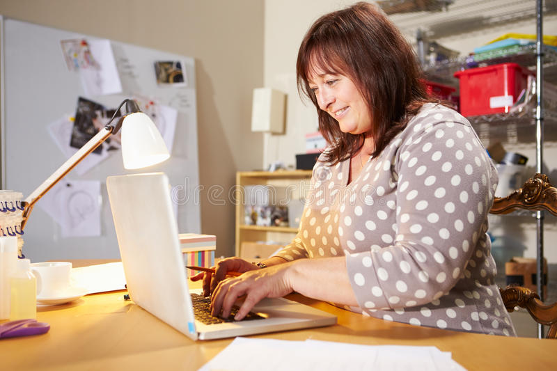 Mature Woman Checking Orders For Home Business On Laptop stock photos
