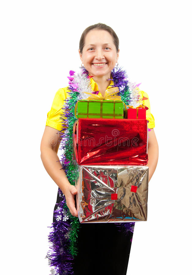 Mature woman with Christmas box. Happy mature woman with Christmas gifts royalty free stock image