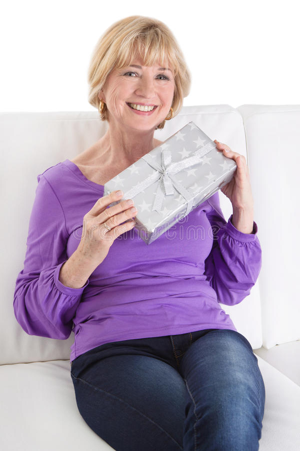 Mature woman with a Christmas Gift. Woman with a Christmas Gift royalty free stock photo