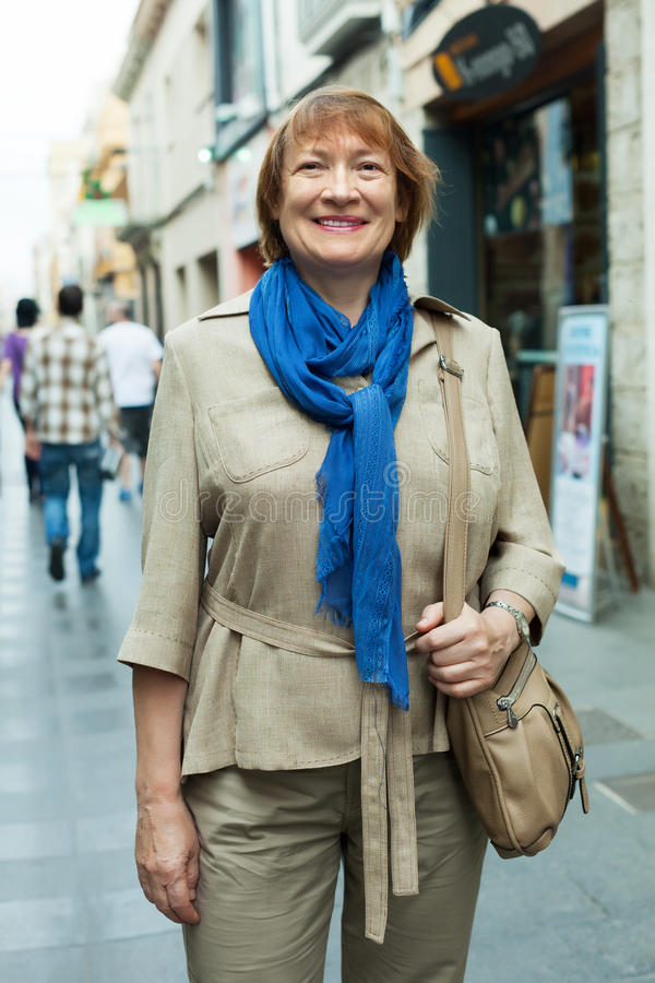 Mature woman in city street stock photography
