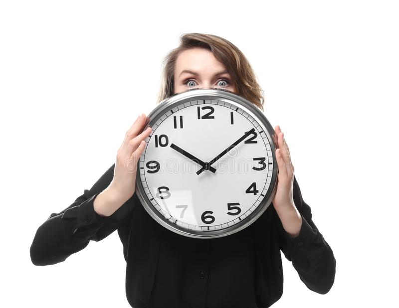 Mature woman with clock on white background. Time management concept stock image