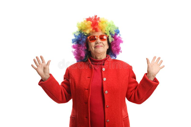 Mature woman with a colorful wig stock photo