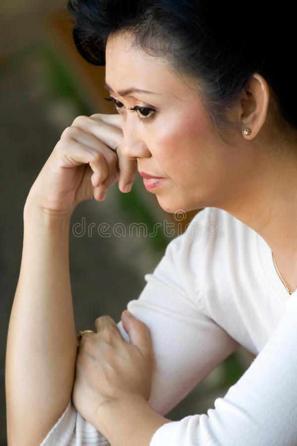 Mature woman contemplating stock photo