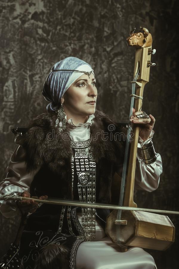 Mature woman in costume royalty free stock photo