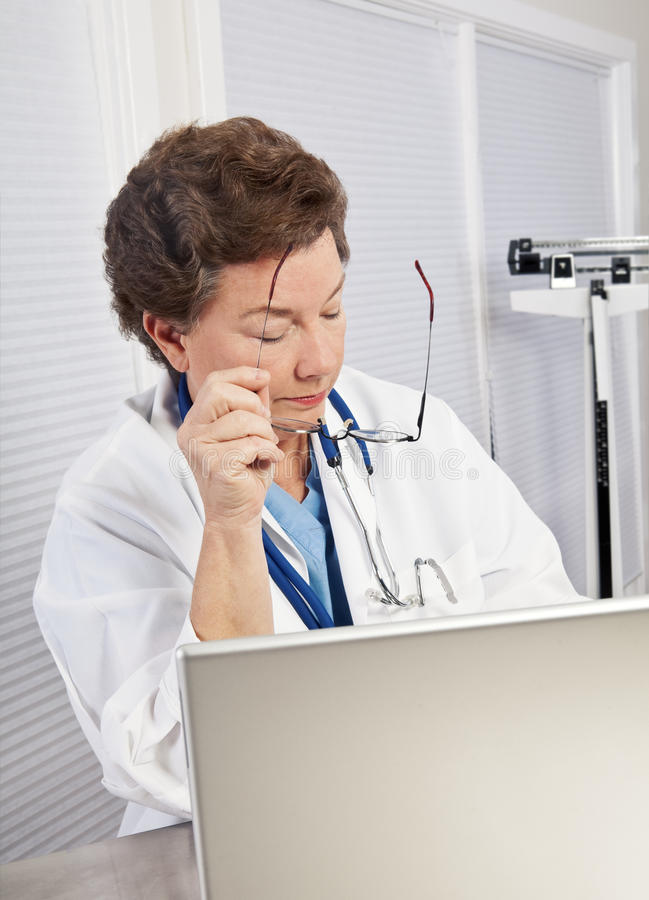 Mature Woman Doctor at Computer stock photography