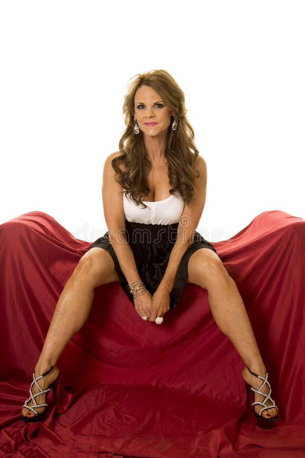 Mature Woman Dress Sit On Red Legs Apart Look Stock Image - Image 49810337-4797